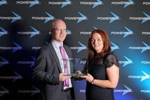 John Devaney receives his award from Head of Sport Liz McLaughlin